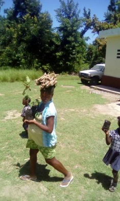 Mother-to-be heads home with her manioc cuttings and fruit tree seedlings