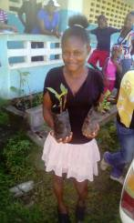 Irois smiling lady w 2 seedlings